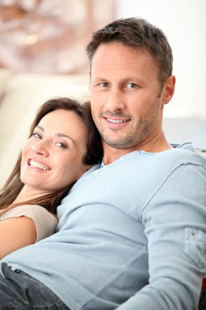 Closeup of happy couple at home photo