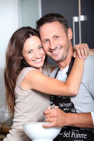 Couple having fun cooking at home photo