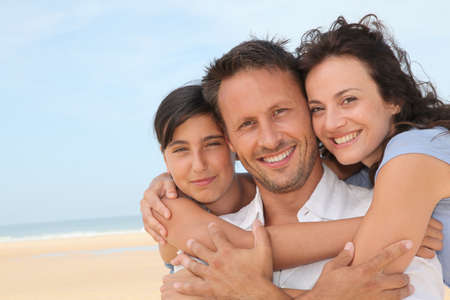 Portrait of happy family at the beach Stock Photo - 7577468