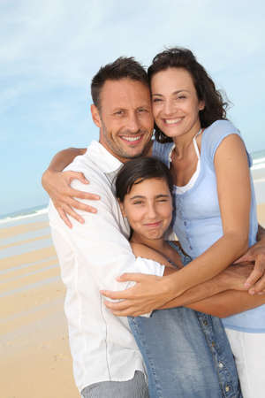 40 years old man: Portrait of happy family at the beach