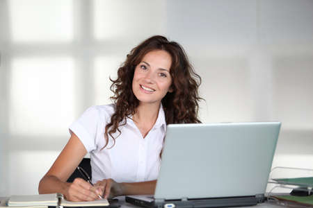 40 year old: Businesswoman in front of computer in the office