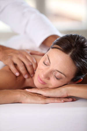 Woman relaxing on a massage bed photo