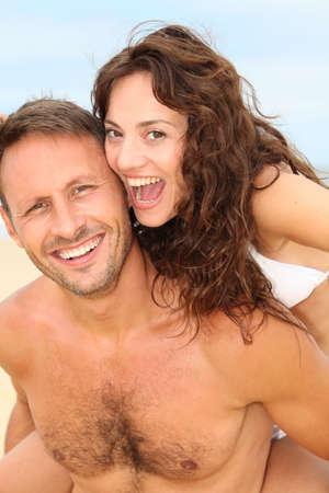 Couple having fun at the beach photo