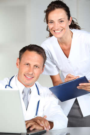 Doctor and nurse working in the office Stock Photo - 7577783