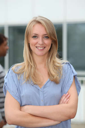 Closeup of beautiful blond woman with arms crossed Stock Photo - 7696315