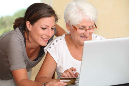Elderly woman and young woman shopping on internet Stock Photo - 7696456