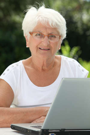 Elderly woman using internet photo