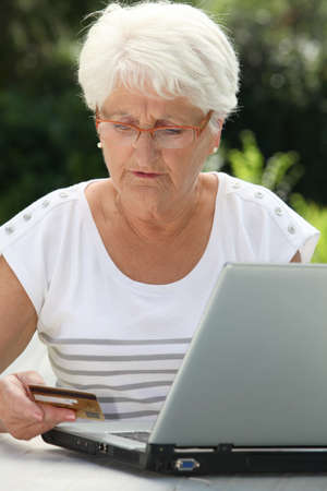 secured payment: Elderly woman buying online