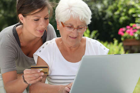 secured payment: elderly woman doing shopping on internet