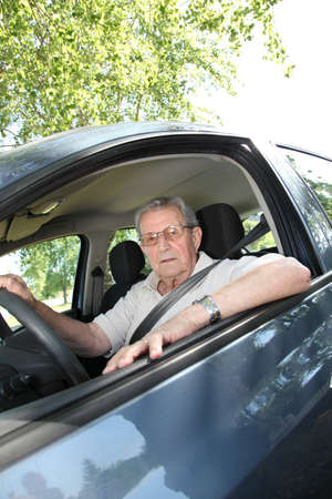 Elderly person driving a car photo