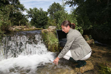 Biologist testing quality of water photo