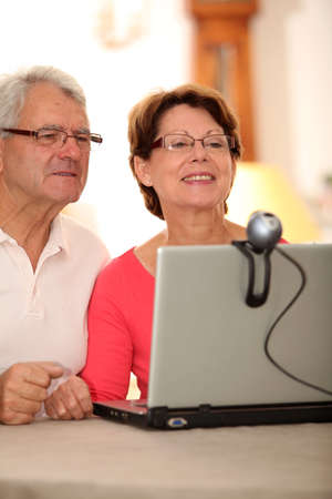 Closeup of senior couple sending messages through webcam Stock Photo - 7695894