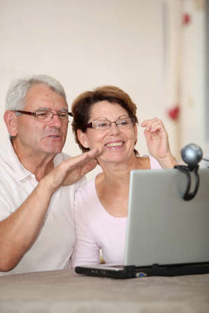 Senior couple and videocall photo