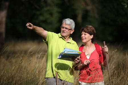 ramble: Senior couple rampling in countryside with map Stock Photo
