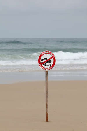 no swimming: Agitated sea with no swimming sign