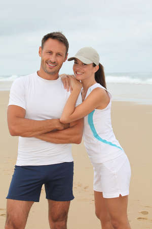 and the horizontal man: Closeup of happy couple in running outfit  Stock Photo