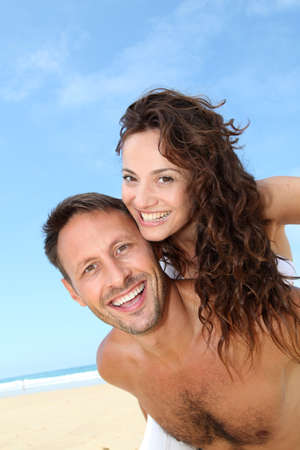 40 years old man: Couple having fun at the beach Stock Photo