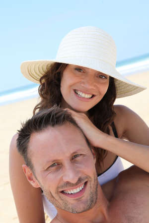 Closeup of happy couple at the beach photo