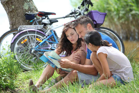 Family on bicycle ride in the countryside photo