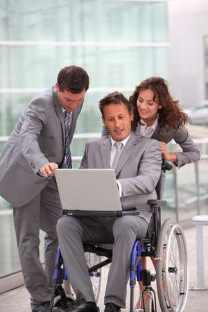 Man in wheelchair in business travel photo