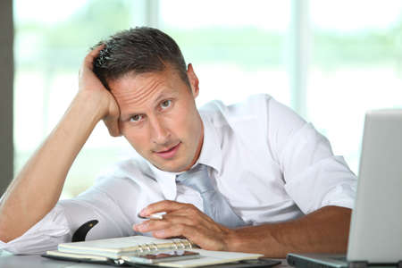 finance director: Businessman spending long hours in the office Stock Photo