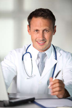 Closeup of doctor working in the office photo