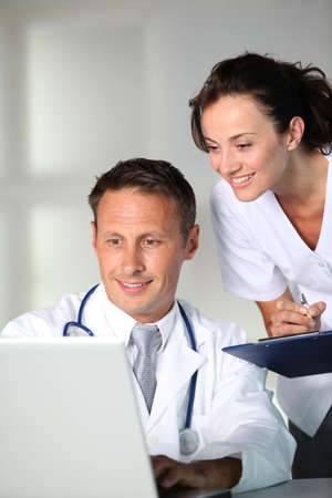 Doctor and nurse working in the office photo