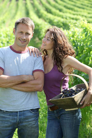 40 years old man: Happy couple standing in vineyard