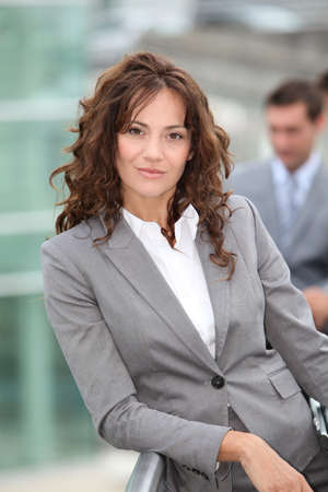 Businesswoman standing outside a building photo