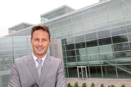 Portrait of businessman in grey suit photo