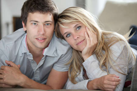 cocooning: Closeup of young couple laying on couch Stock Photo