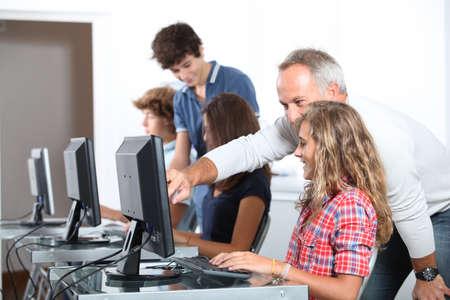 Teenagers in computing class photo