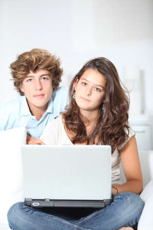 Teenagers with laptop computer photo