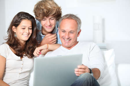 single parent: Family at home with laptop computer