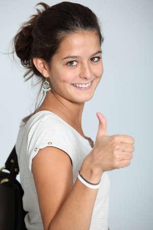 teenaged: Closeup of teenaged girl wth thumb up Stock Photo