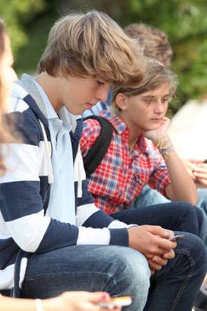 teenaged: Teenaged boy with mobile phone