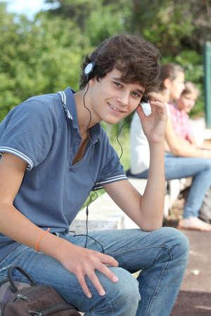 Teenage boy with headphones on photo