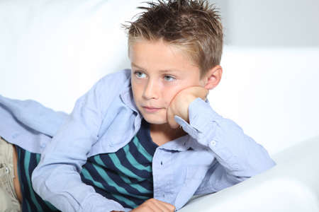 Young boy laying on a sofa at home Stock Photo - 7953898