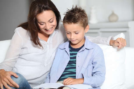 mother and son reading book on a sofa Stock Photo - 7954082