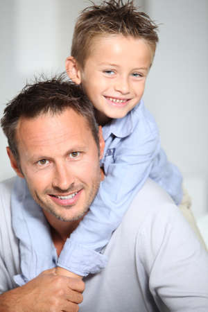 single parent: Closeup of father and son at home