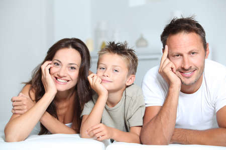 Closeup of parents and child relaxing at home on sofa Stock Photo - 7954009