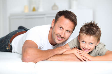 Closeup of father and son at home photo