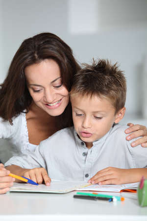 Mother and child doing homework photo