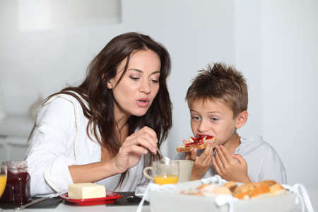 Mother and son having breakfast photo