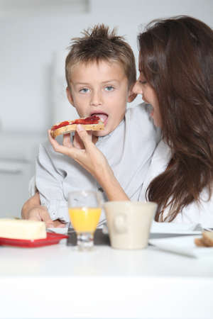 Mother and son having breakfast Stock Photo - 7953917