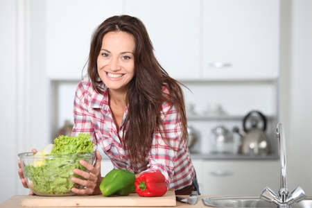 Beautiful woman stading in kitchen photo