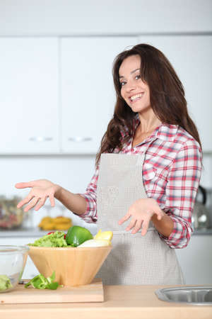 aprons: Beautiful woman stading in kitchen with apron