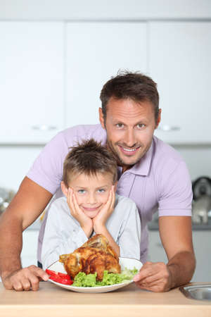Father and son fixing dinner photo