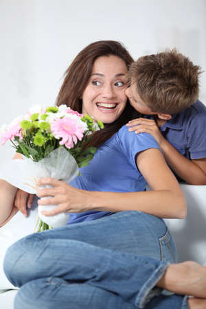 Little boy kissing his mom on mother's day Stock Photo - 7953980