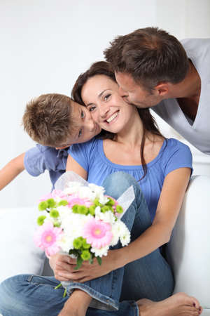 Father and chikd kissing mother for birthday Stock Photo - 10815015